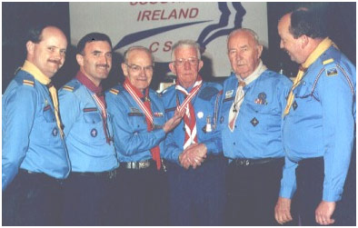The Chief Scout, Peter Dixon (left centre) conferring the Order of the Silver Wolfhound on Bro. Finbarr with from left, David Rogers, Field Commissioner; Pat Murphy, National Executive Board; JD Hally, former Chief Scout and John Culbert, Regional Commissioner