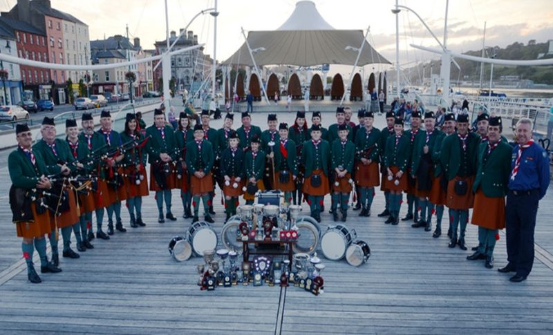 The band on the Plaza in Waterford in 2012 displaying the many trophies won by the individual members and the by the full band