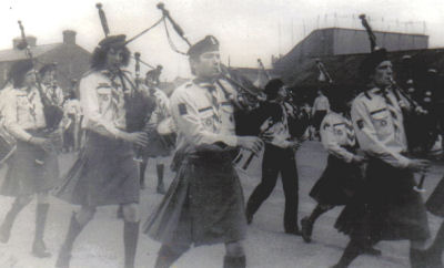 The Pipe Band display the new saffron kilts during the 1970s