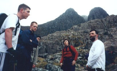 Gary Sinnott, Colm Ennis, Betty Guilfoyle and Paschal Guilfoyle after descending into Stob Coire nam Beith valley with Central Gully and the Church Gate Buttress in the background