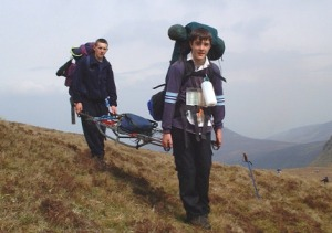 James White and Dylan Lumley bear the stretcher up from the col below Galtymore