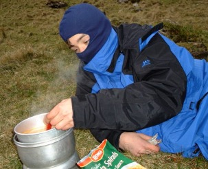 A cold James White toiling over a hot trangia
