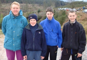 Conor Welsh, Ian Griffin and Derek Ryan of the 3rd/13th on the end of MPC/Sionnach in the Galtees in April 2000 with Tom Casey SL