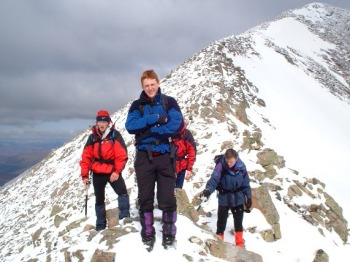 Paul Cunningham, Kenneth Rouse and John Kinsella of the De La Salle Venturers cross the Carn Mor Dearg Arete on Ben Nevis.