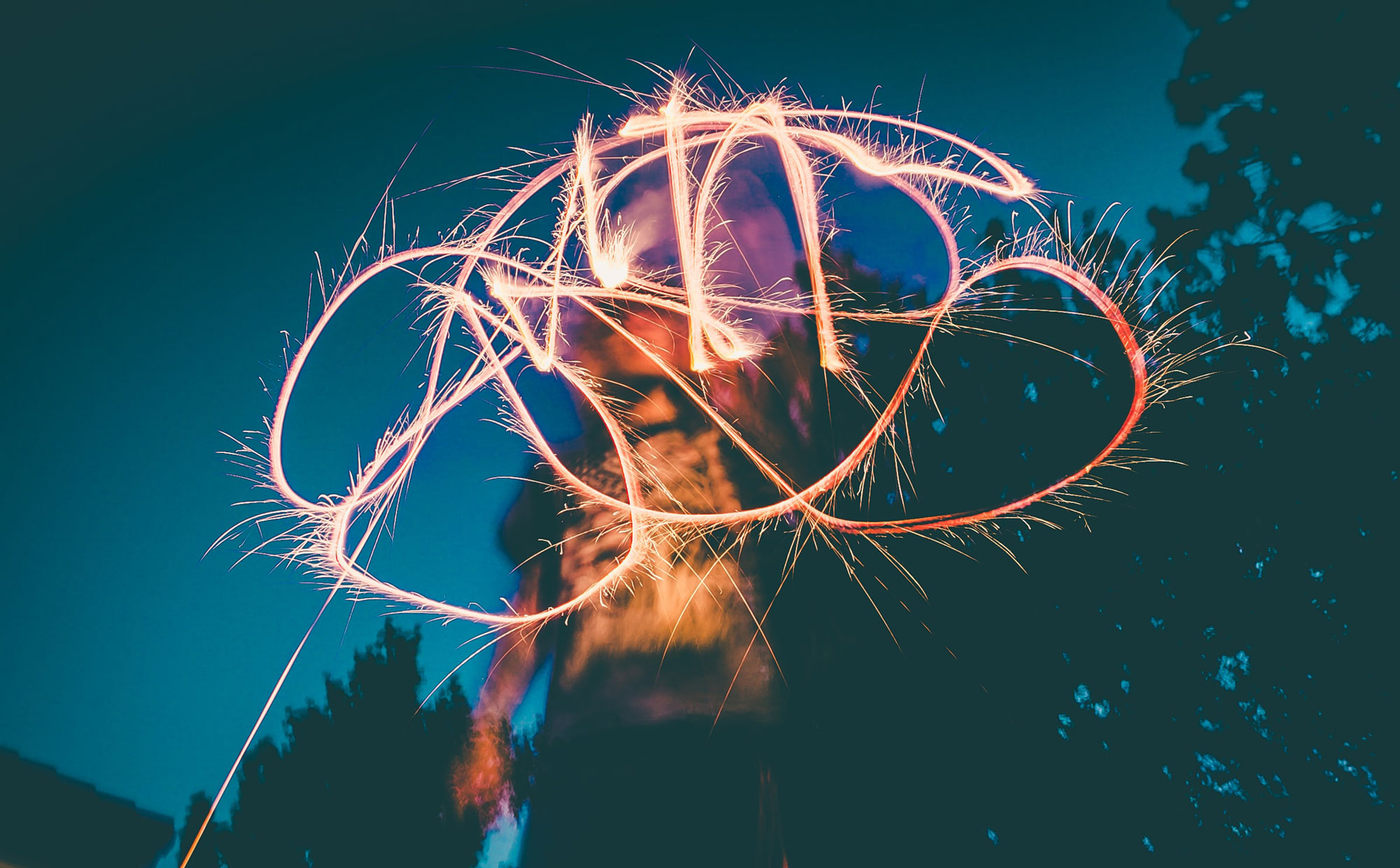 Light drawing with sparkler. Photo by Jakob Owens.