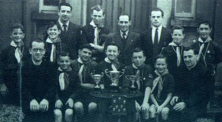 The 7th De La Salle, O'Farrell Cup winners 1956. Back: J Riley, A Chester, T Ryan, L Murphy, Unknown, D Dobbyne, J McCabe, B Collins. Front: Bro. Edmund, O Kennedy, B Hearne, M Power, Ted Ryan (Jnr), T Kavanagh, Fr, Mossy Burke.