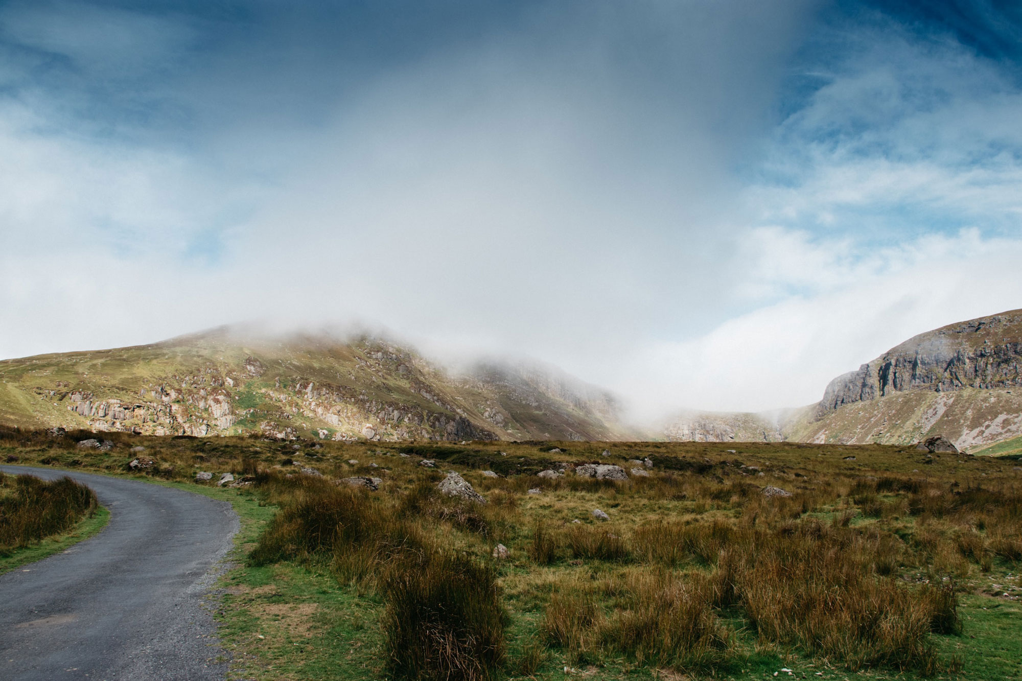 The Comeragh Mountains, near Ireland's south coast, with clouds starting to envelope the craggy cliffs and hills. Photo by Will Francis.
