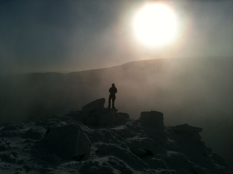 """Looking over the Coumtay valley during winter snows after the first winter ascent of """"Arcg Gully"""" at Coumtay"""