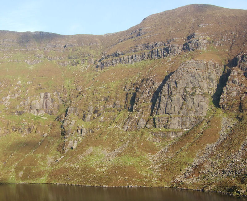 """The sunny South Facing Cliff at Coumshingaun. """"If only ye could turn the Coum around"""" (Sile Daly – IMC)."""