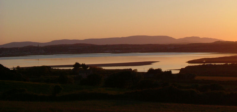 The Comeraghs dominate the landscape of County Waterford. They are seen above from the backstrand in Tramore.