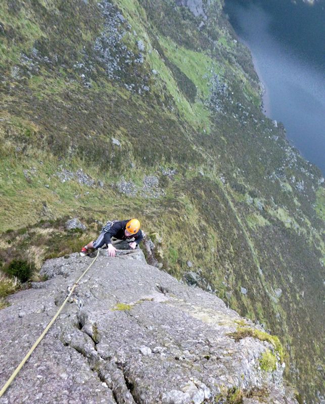 On the excellent finishing arête of 'A Walk on the West End' (VS? 4a 4c) in the Coum